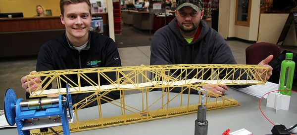 Students with a bridge model