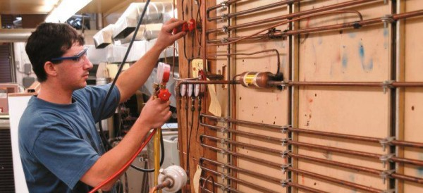 Student working in the HVAC lab
